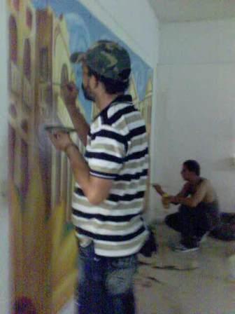 Proceso de realización de la pintura mural(Jorge Luis Sanfiel y Aliegmis Bravo Cuan)