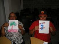Talleristas: Osmil y Yasmani, mostrando sus trabajos